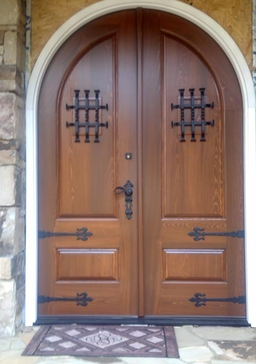 Arched Top Double Doors With Iron Strap Hinges