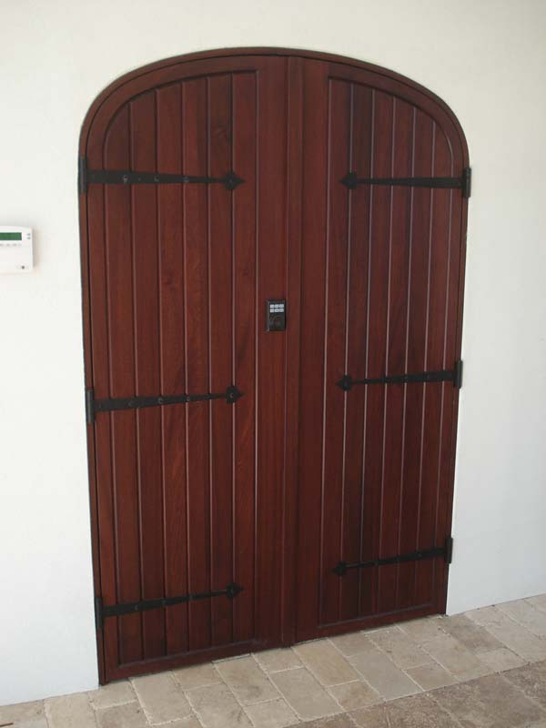 arched top custom door with strap hinges